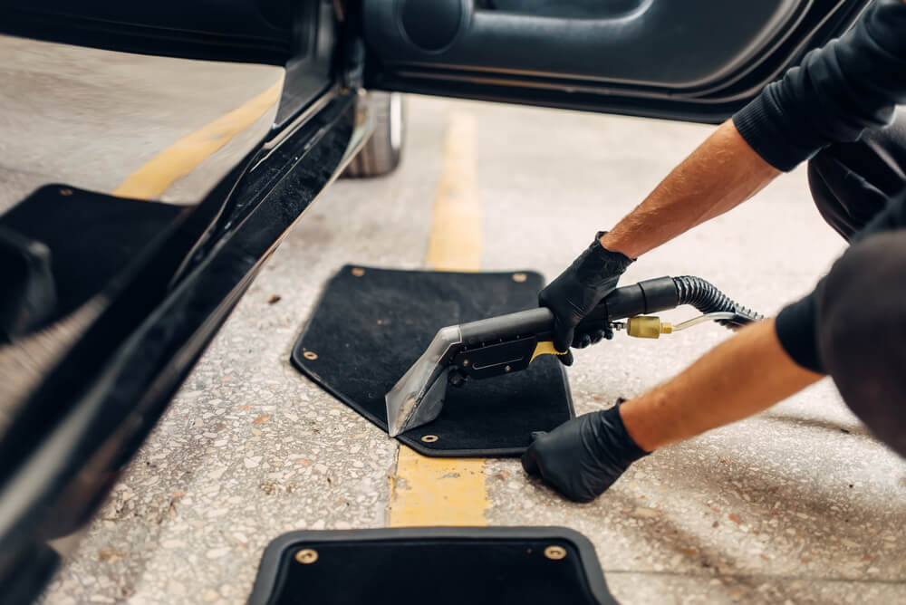 cleaning car mats - NOLA Automotive Repairs